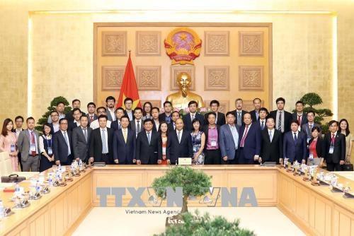 Thủ tướng Nguyễn Xuân Phúc với các đại biểu tại buổi gặp mặt. Ảnh: Thống Nhất/TTXVN.