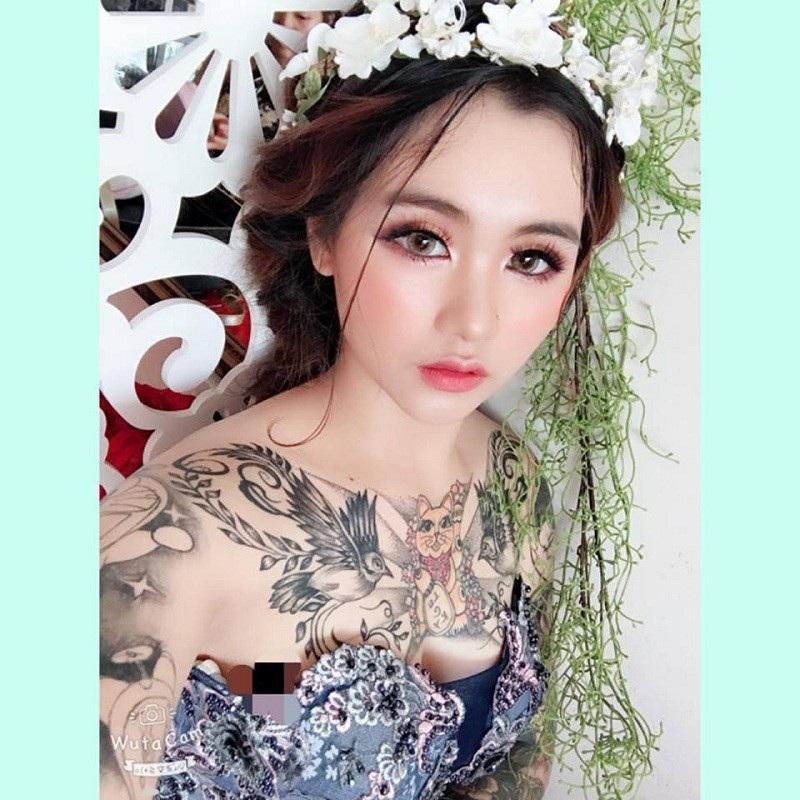 Cô gái xinh đẹp xăm kín người khoe ảnh váy cưới gây sốt mạng - 4