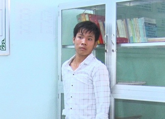 Phan Quốc Vĩnh tại cơ quan công an. Ảnh: Công an cung cấp