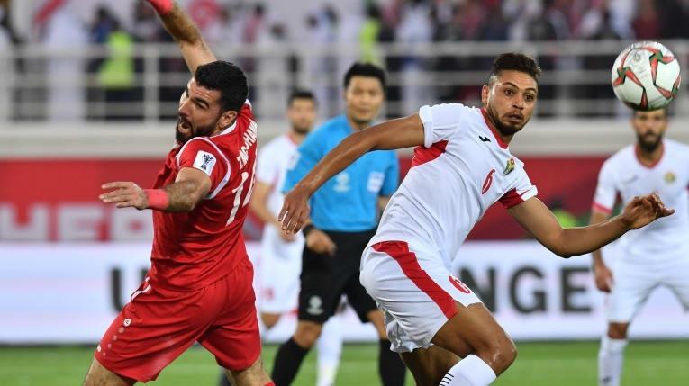 Đánh bại Syria, Jordan là đội đầu tiên vượt qua vòng bảng - Ảnh 2.