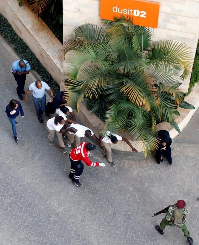 Khách sạn sang trọng chìm trong khói lửa do bị khủng bố, 15 người chết - Ảnh 8.