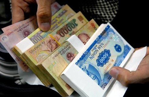 Tết này đổi tiền lẻ không đúng quy định sẽ bị xử phạt - Ảnh 1.