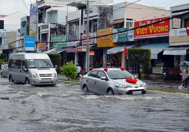 Ảnh hưởng bão số 1, Bạc Liêu - Cà Mau ngập nặng vì mưa lớn - 7
