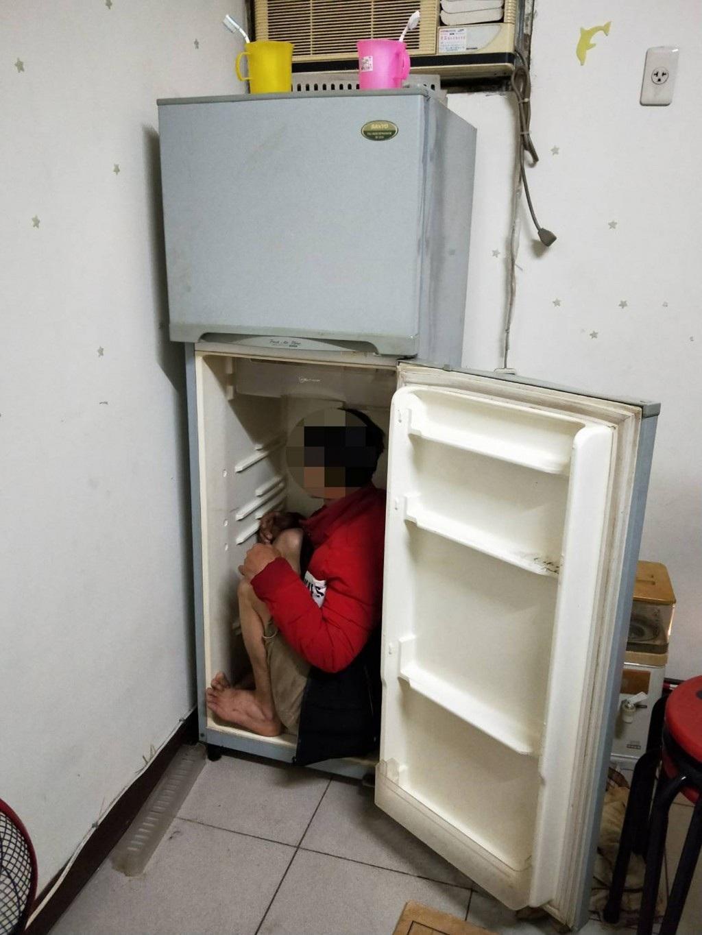 Đài Loan bắt người Việt trốn trong tủ lạnh - Ảnh 1.