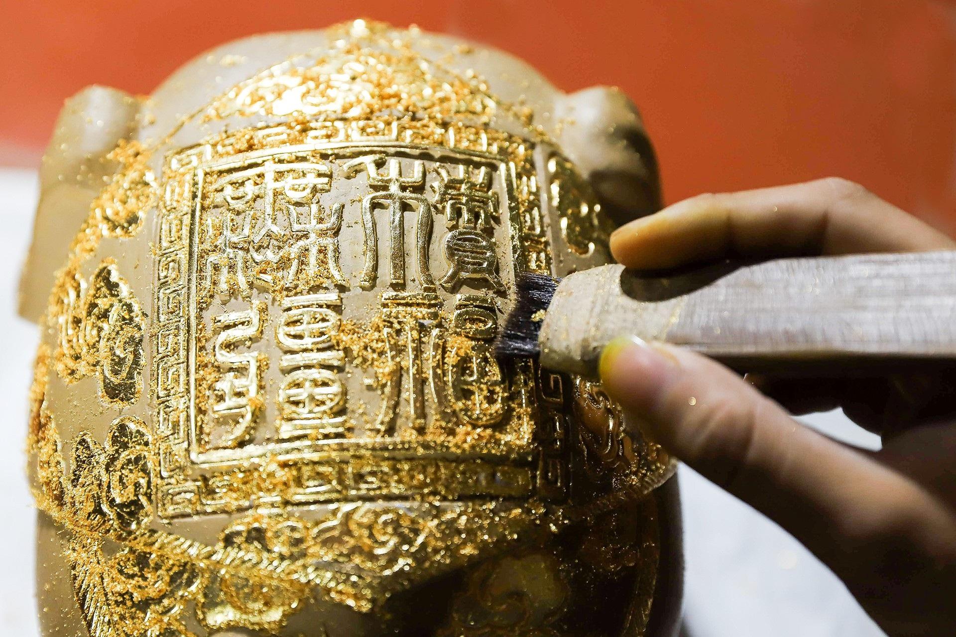 Lợn đất dát vàng được săn đón dịp Tết Kỷ Hợi  - Ảnh 8.