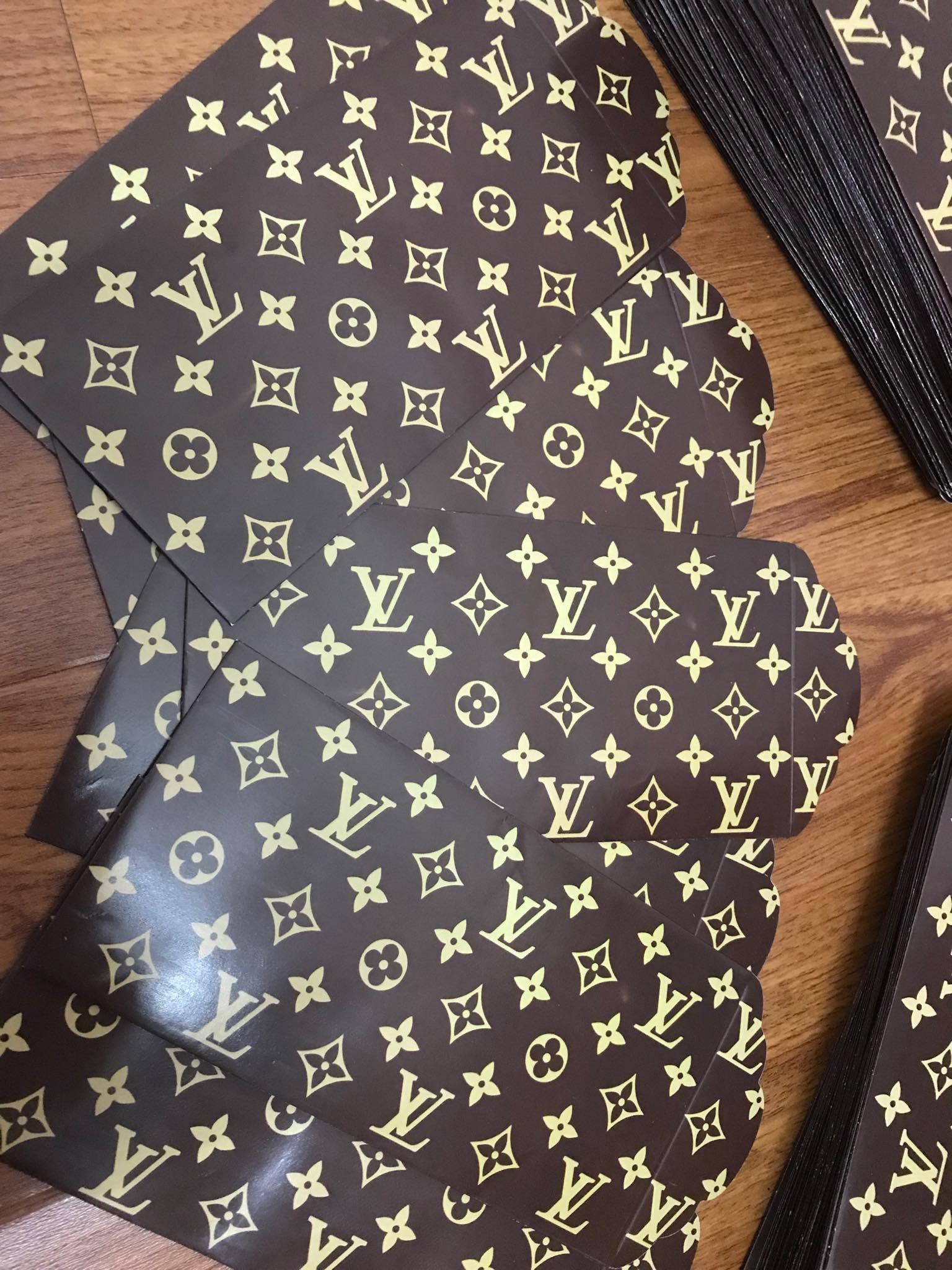 Lì xì sang chảnh in chữ ánh vàng theo thương hiệu nổi tiếng siêu hút khách - Ảnh 7.