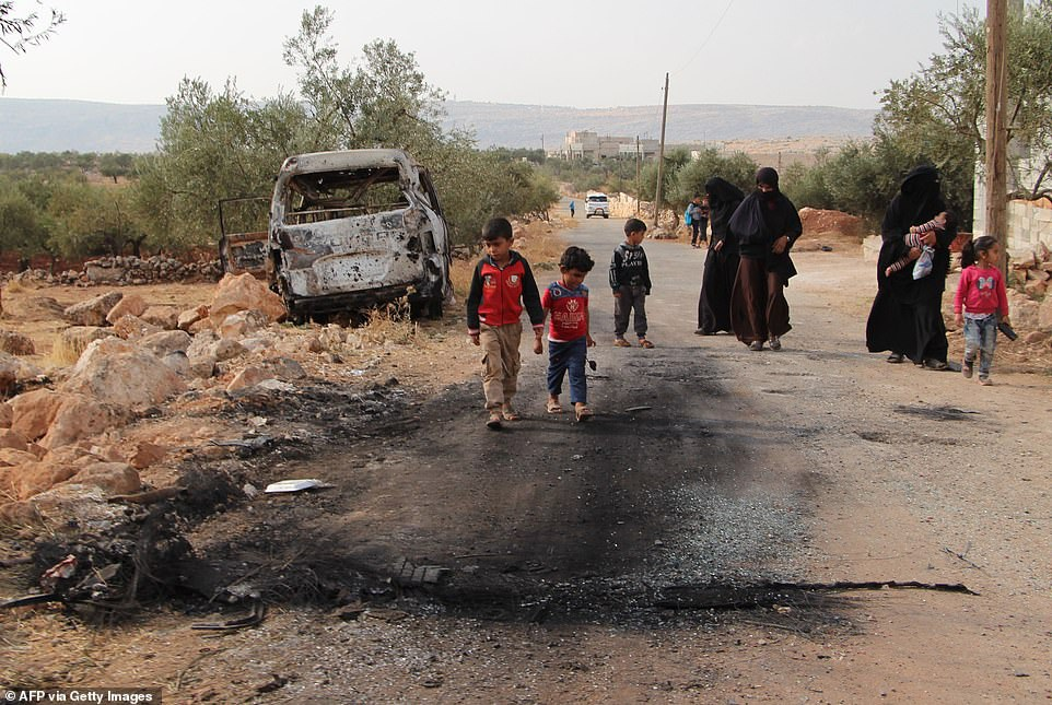 Hang ổ của thủ lĩnh IS bị san phẳng trong cuộc đột kích của Mỹ - 14