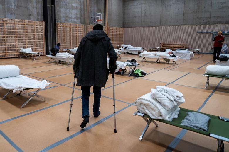 """Người vô gia cư chật vật sinh tồn giữa """"bão"""" Covid-19 càn quét toàn cầu - 12"""
