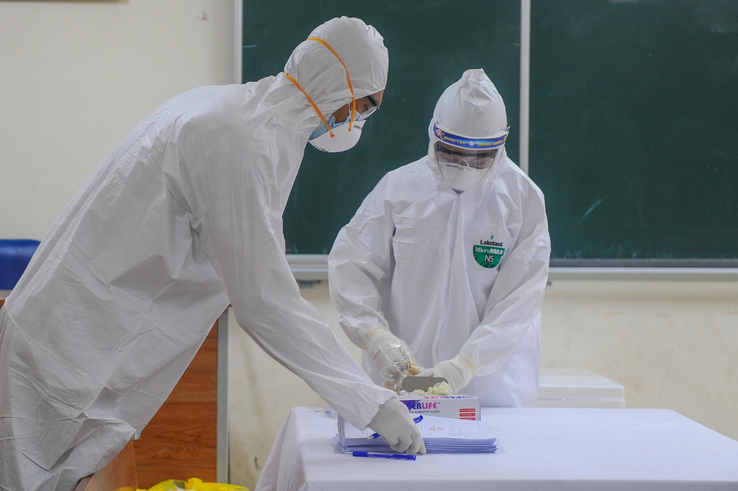 Hà Nội: Ngày đầu xét nghiệm PCR cho người trở về từ vùng dịch Đà Nẵng - 12
