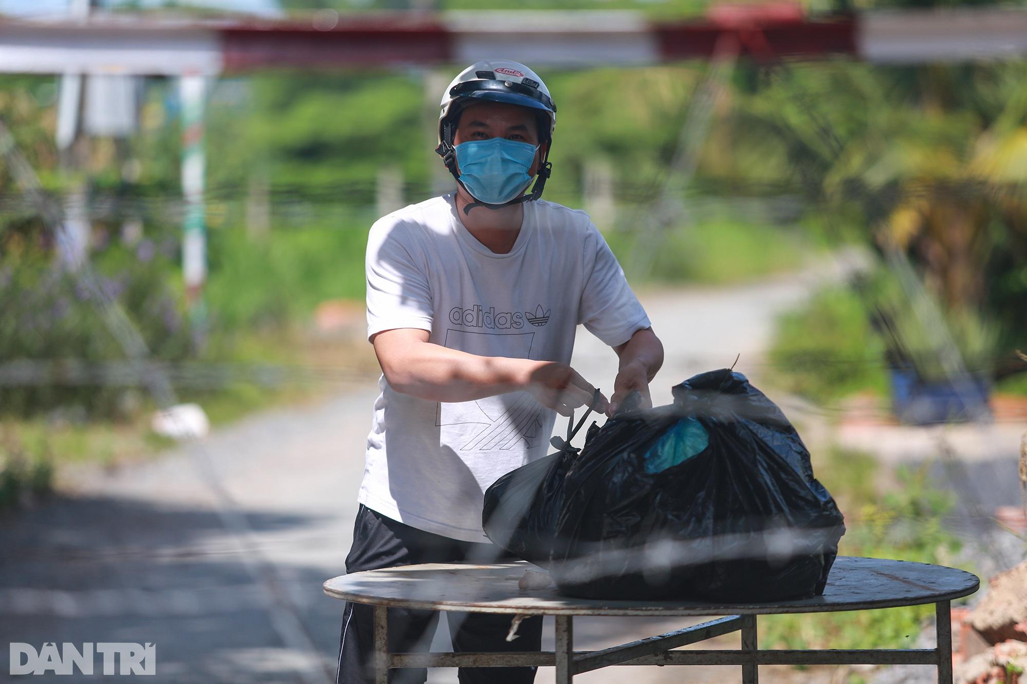 Phong tỏa ổ dịch có 16 ca nhiễm SARS-CoV-2 trong khu hơn 1.000 dân ở Củ Chi - 3