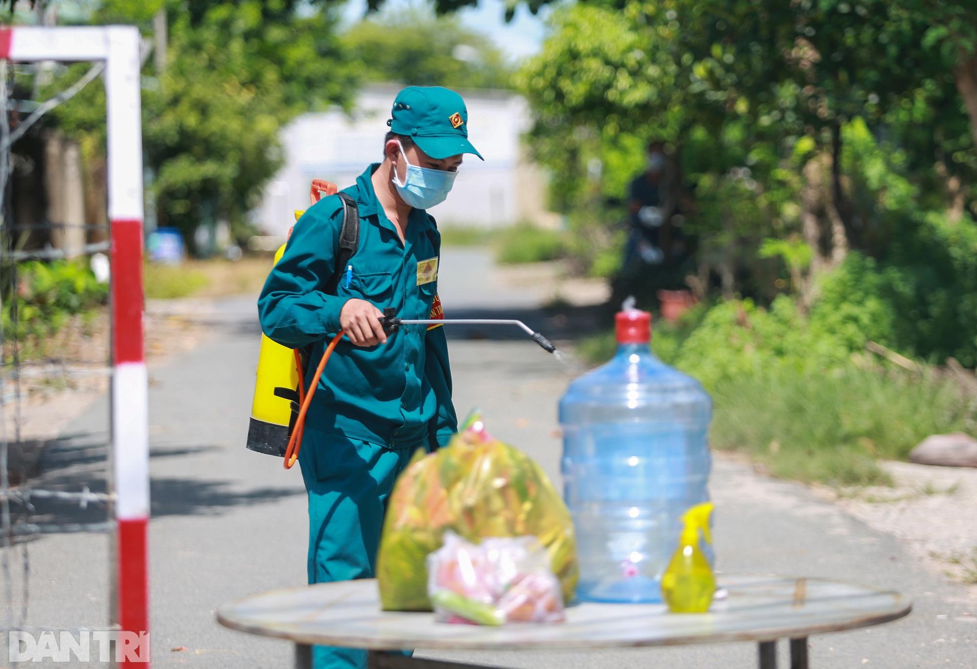 Phong tỏa ổ dịch có 16 ca nhiễm SARS-CoV-2 trong khu hơn 1.000 dân ở Củ Chi - 10