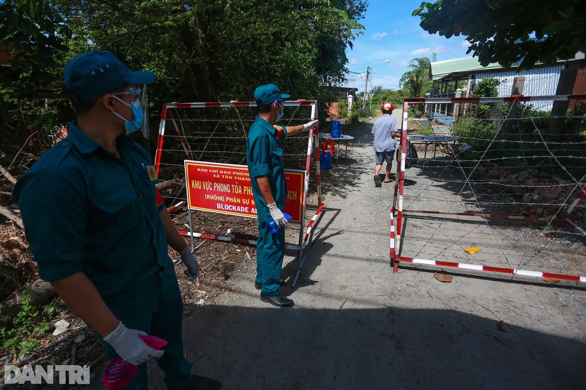 Phong tỏa ổ dịch có 16 ca nhiễm SARS-CoV-2 trong khu hơn 1.000 dân ở Củ Chi - 2