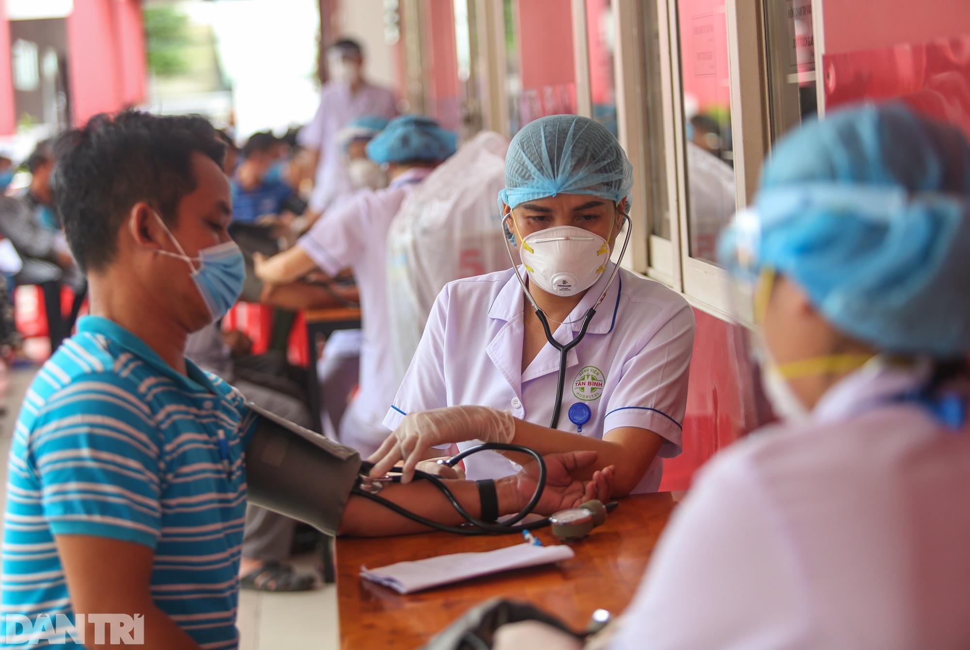 TPHCM dùng trường học, nhà thi đấu để tiêm vắc xin Covid-19 cho 1 triệu dân - 13
