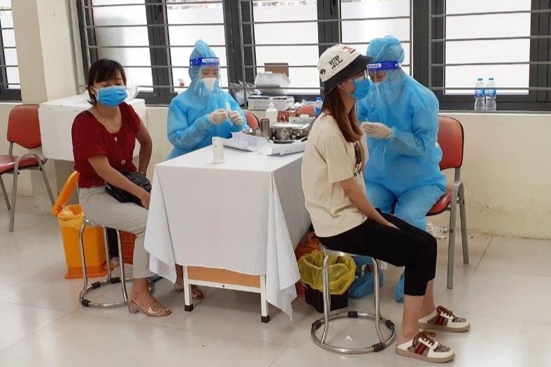 Toàn cảnh chiến dịch thần tốc bao phủ vắc xin Covid-19 tại Hà Nội - 12