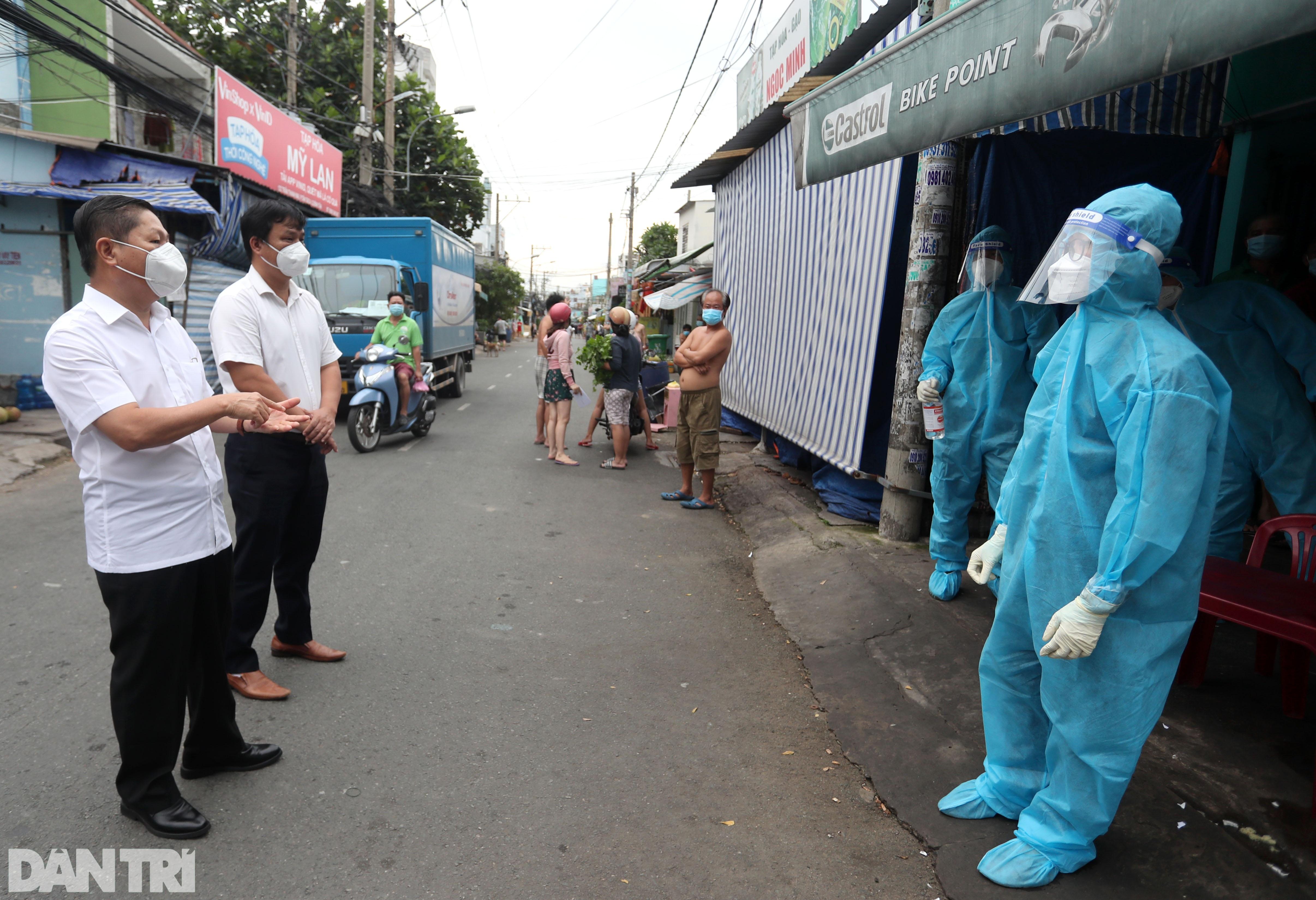 Thứ trưởng Bộ LĐ-TBXH thị sát đời sống người dân tại TPHCM - 9