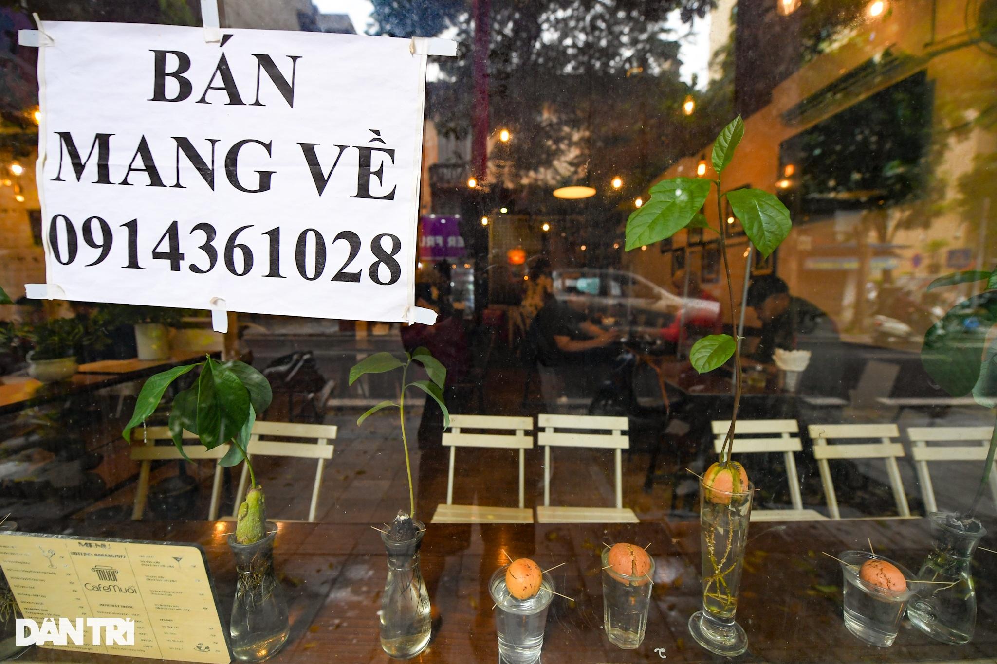 Hàng ăn, quán cafe tấp nập trong ngày đầu phục vụ khách tại chỗ - 8