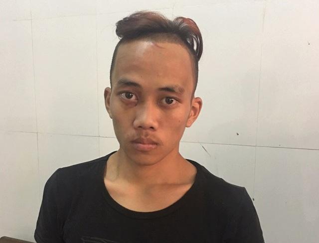 Đối tượng Nguyễn Tiến Trình tại cơ quan điều tra Công an TP Vinh.