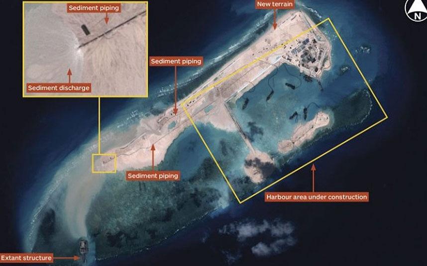 Ảnh vệ tinh cho thấy các hành động cải tạo, xây dựng phi pháp của Trung Quốc tại bãi đá Chữ Thập.