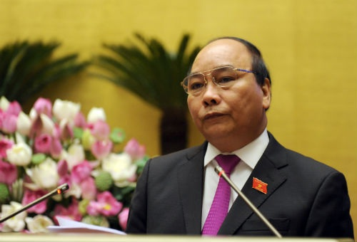 Thủ tướng Nguyễn Xuân Phúc trong phiên trả lời chất vấn tại Quốc hội khóa XIII sáng 13/6/2015 (ảnh: Chinhphu.vn).