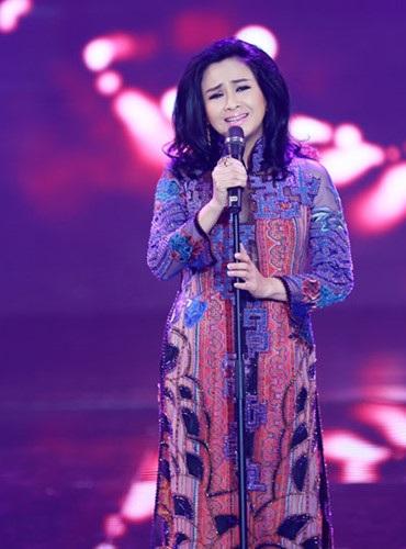 Thanh Lam xinh đẹp rạng ngời trong chiếc áo dài của NTK Minh Hạnh. Ảnh: NVCC.