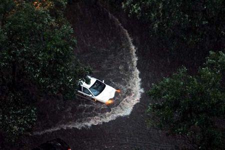 Mưa lớn gây ngập nặng tại Bắc Kinh, giao thông đình trệ - 5