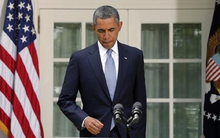 Tổng thốngObama đang đau đầu với việc chính phủ Mỹ bị đóng cửa.