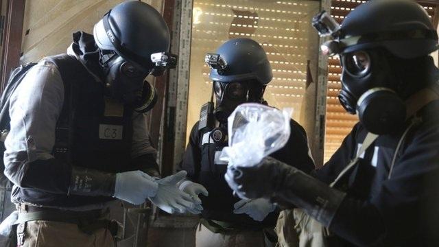 Đoàn thanh sát viên LHQ giám sát một kho vũ khí hóa học ở Syria.