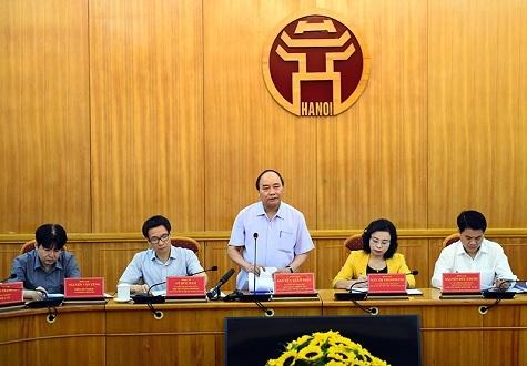 Thủ tướng Nguyễn Xuân Phúc làm việc với Hà Nội về kết quả thực hiện Chỉ thị 13 (Ảnh: Chính phủ)