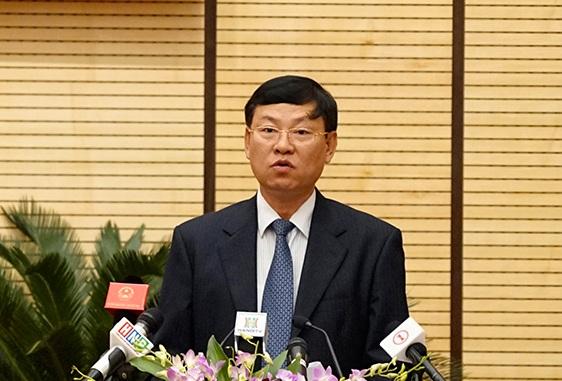 Ông Nguyễn Hữu Chính - Chánh án Tòa án nhân dân TP Hà Nội báo cáo trước HĐND TP công tác năm 2016 và nhiệm vụ năm 2017