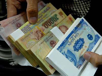 Kể từ ngày 20/1/2014, người dân khi đổi tiền rách, hỏng sẽ không phải nộp phí.