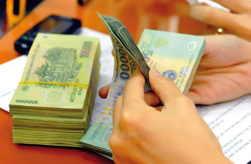 Thu nhập nhân viên ngân hàng sụt giảm mạnh (ảnh minh họa).