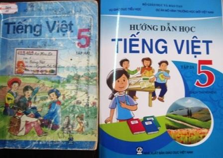 """Hai cuốn sách Hướng dẫn học Tiếng Việt và Tiếng Việt lớp 5 có đoạn văn """"lạ"""" về sự tích Thánh Gióng."""