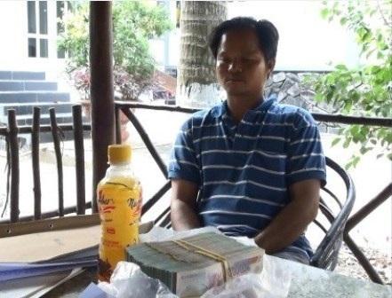 Võ Văn Minh và tang vật vụ án.