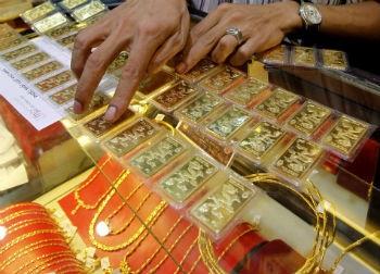 Giá vàng có thể về vùng 705 USD/ounce vào quãng cuối quý III đầu quý IV năm 2014?.