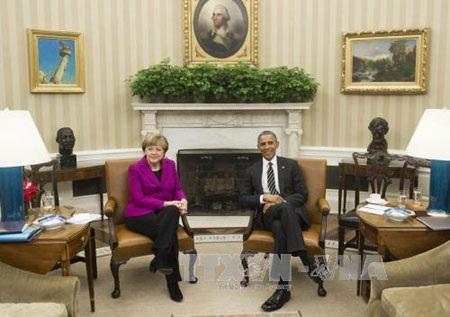 Tổng thống Mỹ Barack Obama gặp Thủ tướng Đức Angela Merkel hôm 9/2/2015 (Ảnh: AFP/TTXVN)