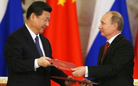 Chủ tịch Trung Quốc Tập Cận Bình (trái) và Tổng thống Nga Vladimir Putin (Ảnh: scmp.com)