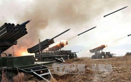 Pháo binh Triều Tiên tập trận giả định hồi tháng 2 (Ảnh: AFP/TTXVN)