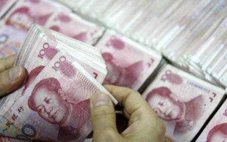 Đồng Nhân dân tệ của Trung Quốc đang chiếm ưu thế so với đồng USD (Ảnh AFP)