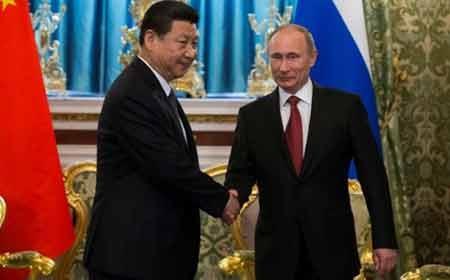 Chủ tịch TQ Tập Cận Bình và Tổng thống Nga Putin (Ảnh: AP)