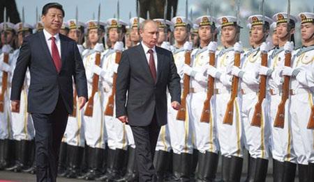 Chủ tịch TQ Tập Cận Bình và Tổng thống Nga Putin. (Ảnh: