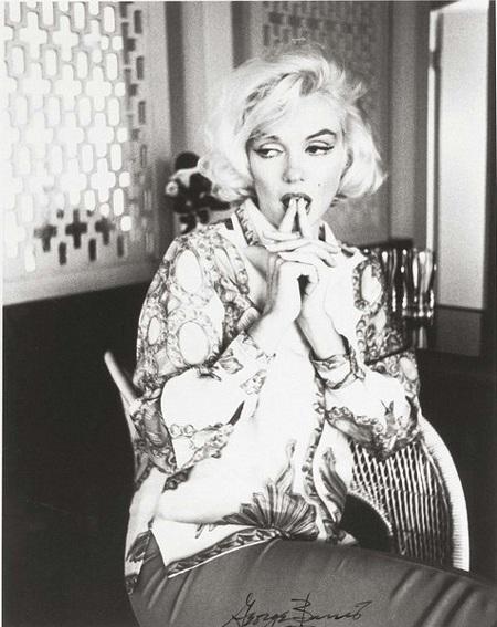 Mái tóc vàng, bờ môi gợi cảm và nốt ruồi kiêu hãnh đã làm nên thương hiệu Marilyn Monroe.