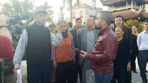 Quy chế mới của UBND huyện Vụ Bản và phản ứng của người dân với PV Dân trí.