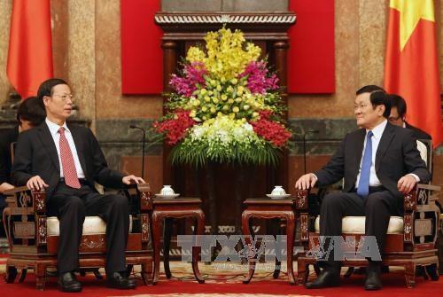Chủ tịch nước Trương Tấn Sang tiếp đồng chí Trương Cao Lệ (trái). Ảnh: Nguyễn Khang – TTXVN