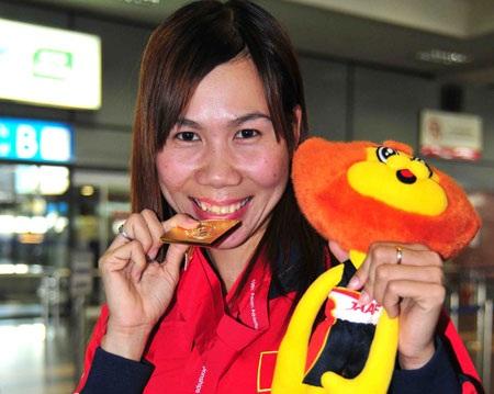 100 triệu cho VĐV điền kinh đạt chuẩn Olympic 2012 tại SEA Games 26 - 1