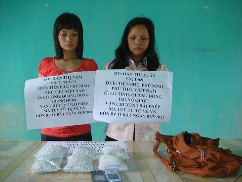 Hai chị em ruột vận chuyển 6.000 viên ma túy qua biên giới - 1
