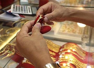 Vàng có thể chạm mốc 30 triệu đồng/lượng vào đầu 2010 - 1