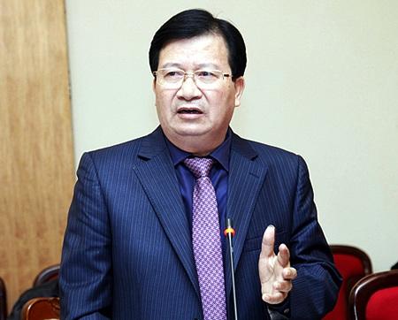Bộ trưởng Xây dựng Trịnh Đình Dũng trình bày nội dung dự luật Kinh doanh BĐS sửa đổi.