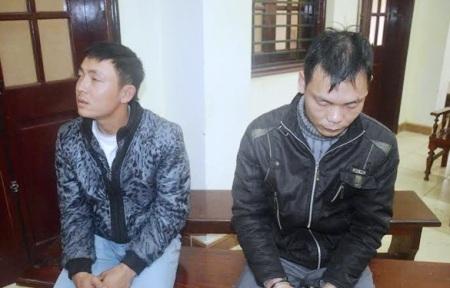 Đối tượng Nguyễn Văn Chính (bên phải) và Nguyễn Anh Tình