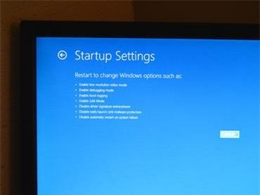 Trong trình đơn Startup Setting, chọn nút