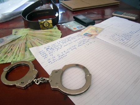 Hai đối tượng Phan Bá Hùng và Nguyễn Văn Tú tại phiên tòa ngày 26/12.